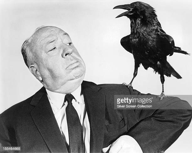 English director Alfred Hitchcock poses with a stuffed crow in a promotional portrait for his film 'The Birds' 1963