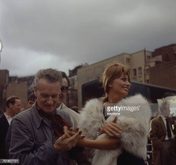 English director Anthony Asquith holding the hand of his star Italian actress Sophia Loren on the set of the film 'The Millionairess' London UK 12th...