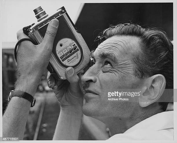 English director David Lean, pictured on the set of a film using a hand held Revere 16mm camera, circa 1950-1965.