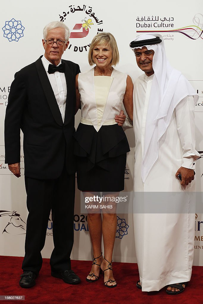 English director Michael Apted (L) and his wife Jo (C) pose for a photo with the Chairman of the Dubai International Film Festival Abdulhamid Juma (R) during the opening ceremony of the Dubai International Film Festival in Gulf emirate of Dubai on December 9, 2012.