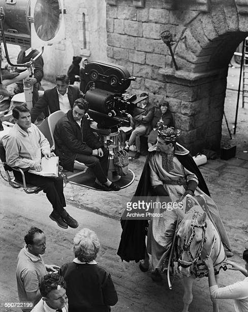 English director Peter Glenville ready for a scene with Irish actor Peter O'Toole on horseback as Thomas Becket Archbishop of Canterbury during...