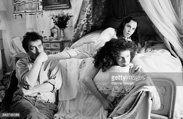 English director Stephen Frears and American actor John Malkovich and Laura Benson on the set of the film Dangerous Liaisons based on the Choderlos...