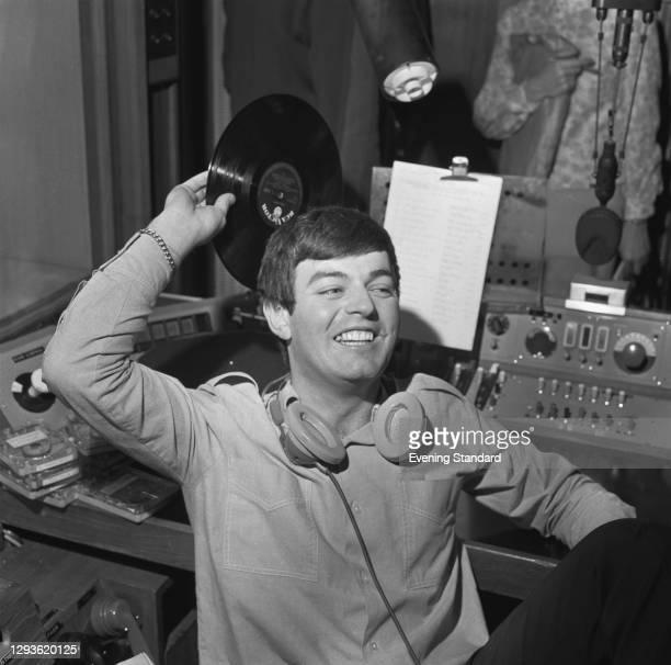 English disc jockey and singer Tony Blackburn becomes the first disc jockey to broadcast on the new BBC Radio 1, London, UK, 30th September 1967.