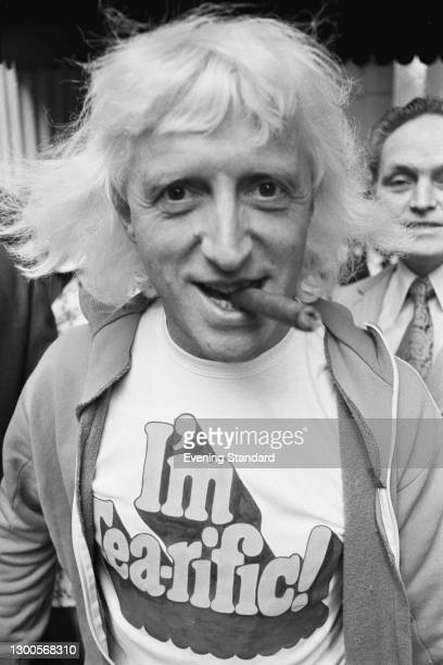 English disc jockey and television personality Jimmy Savile wearing a t-shirt which reads 'I'm Tea-rific' during a Variety Club of Great Britain...