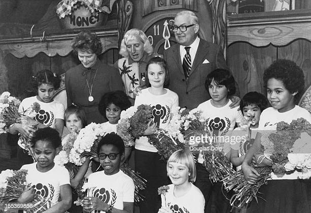 English disc jockey and television presenter From left to right Baroness Soames Jimmy Savile and Prime Minister James Callaghan at the launch of the...