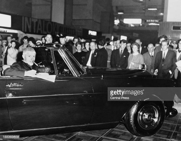 English disc jockey and television presenter Jimmy Savile buys a new Rolls Royce Silver Cloud III Drop Head Coupe at the Motor Show in Earl's Court...