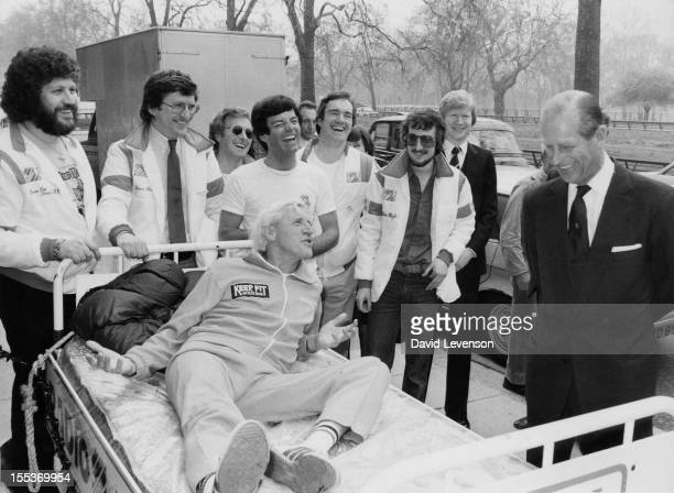 English disc jockey and television presenter Jimmy Savile chats with the Duke of Edinburgh during a Variety Club of Great Britain charity walk lunch...