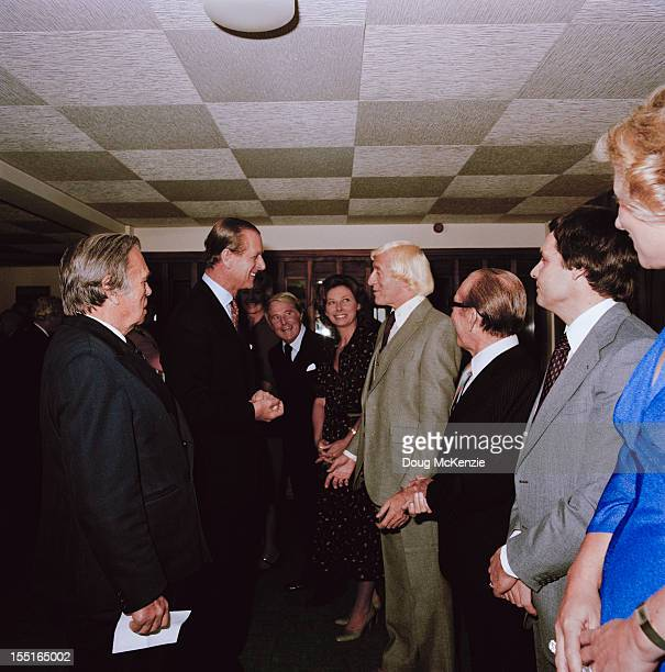 English disc jockey and television presenter Jimmy Savile meets the Duke of Edinburgh in Jersey November 1979 Comedian Ernie Wise is in background...