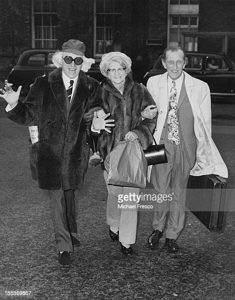 English disc jockey and television presenter Jimmy Savile with his mother Agnes and fellow hospital porter Joe Tyrer March 1972