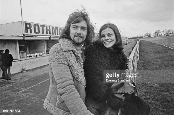 English disc jockey and television presenter Noel Edmonds with his wife Gillian at a race track, UK, March 1973.