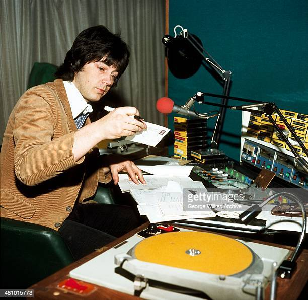 English disc jockey journalist and television personality Mike Read works in his studio London England 1981