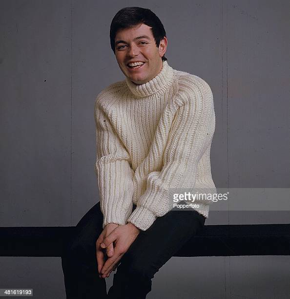 English disc jockey Tony Blackburn posed wearing a cream coloured ribbed roll neck sweater in 1968.