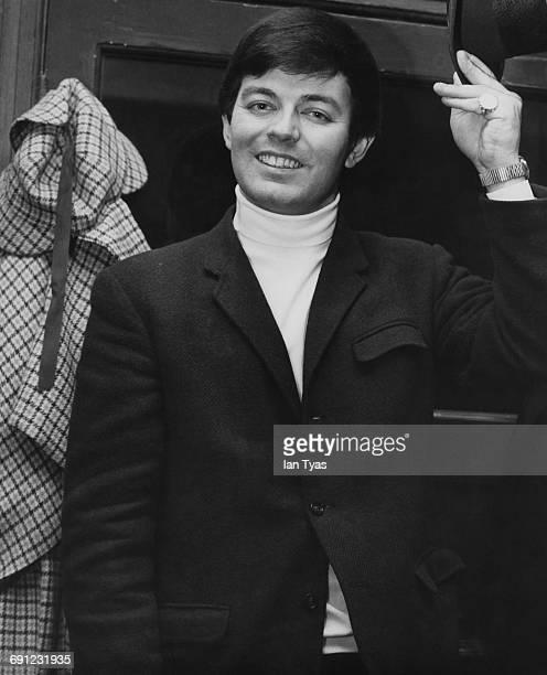 English disc jockey Tony Blackburn visits the Sherlock Holmes pub in Northumberland Street, London, 1968.