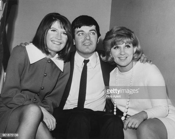 English disc jockey Tony Blackburn with singers Sandie Shaw and Jackie Trent during a press reception at the Waldorf Hotel in London 3rd January 1968...