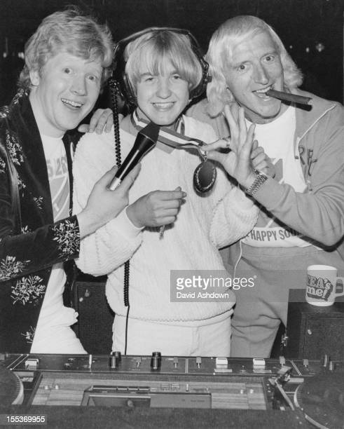 English disc jockeys Kid Jensen and Jimmy Savile present the prize for 'Britain's Top Young DJ' to 21yearold Graham Thornton during the final of the...