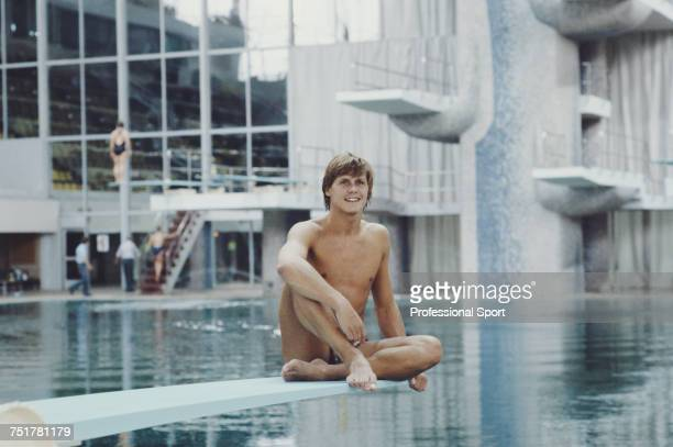 English diver Chris Snode pictured sitting on a springboard at the Olimpiysky Sports Complex swimming pool during competition for the Great Britain...