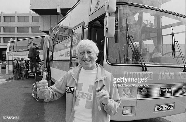 English DJ and broadcaster Jimmy Savile in front of the Jumbulance ambulance in London on 29th May 1980