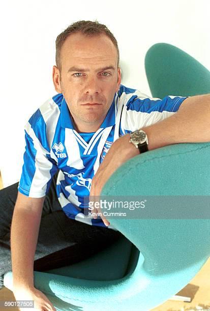 English DJ and record producer Fat Boy Slim wearing a Brighton And Hove Albion football shirt circa 2000
