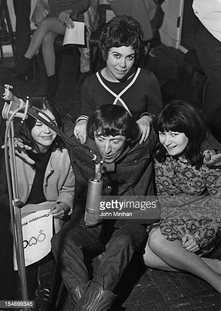 English dj and television presenter Jimmy Savile at Radio Luxembourg with Carol Abramson Gill Sandgrove and Pauline Jones 7th December 1967