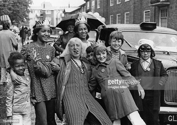 English dj and television presenter Jimmy Savile joins a group of underprivileged and disabled children on a day out to Southend organized by London...