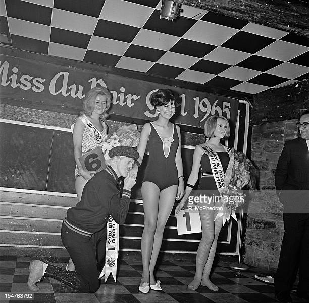 English dj and television presenter Jimmy Savile kneels to kiss the hand of Beauty queen Inga Lill Waldridson winner of the 'Miss Au Pair 1965'...