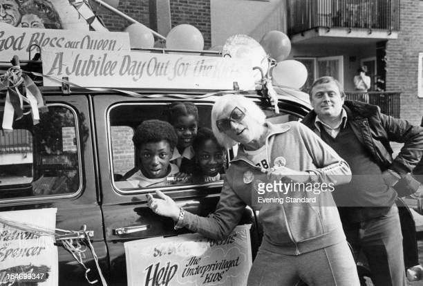 English dj and television presenter Jimmy Savile seeing off a group of underprivileged children on a day out organized by London taxi drivers 1st...