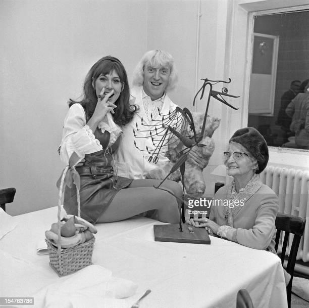 English dj and television presenter Jimmy Savile with English actress Anita Harris and his mother Agnes 5th November 1968