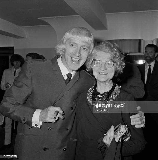 English dj and television presenter Jimmy Savile with his mother Agnes at a Variety Club lunch London 14th September 1965