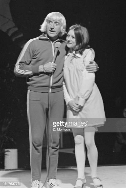 English dj and television presenter Jimmy Savile with Mary Ross winner of the Daily Express Sound '72 competition 17th May 1972