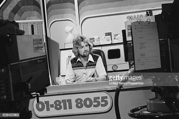 English DJ and television presenter Noel Edmonds pictured presenting the children's television programme MultiColoured Swap Shop at BBC Television...