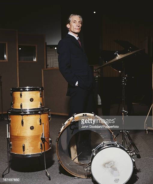 English drummer Charlie Watts of The Rolling Stones posed with drum kit in 1992