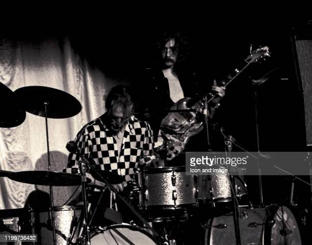 English drummer, Ginger Baker, and English rock and blues guitarist, singer, and songwriter, Eric Clapton, perform with Cream at the Sam Houston...