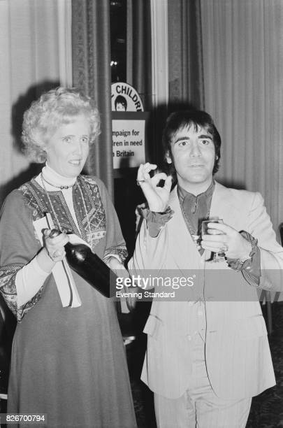 English drummer Keith Moon with Labour politician Marcia Falkender at a charity event 24th February 1978