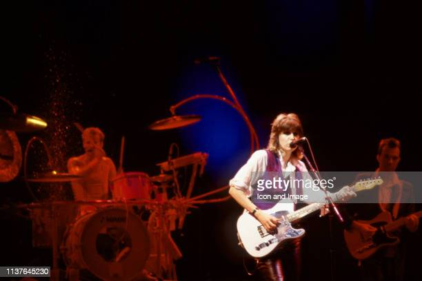 English drummer Martin Chambers, American lead singer Chrissie Hynde of the rock group The Pretenders sings on stage during the 1984 Learning to...