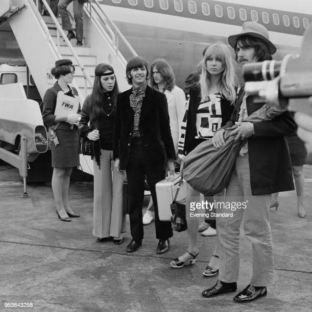 English drummer Ringo Starr with his wife Maureen Cox and English guitarist George Harrison with his wife Pattie Boyd at Heathrow Airport, London,...