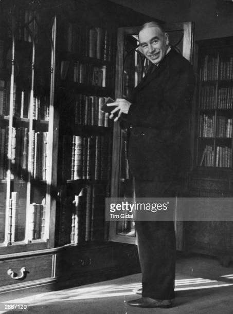 English economist John Maynard Keynes , 1st Baron Keynes in his study with his collection of rare books. Original Publication: Picture Post - 361 -...