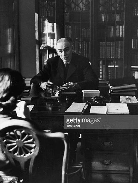 English economist John Maynard Keynes , created 1st Baron Keynes of Tilton, in his study in Bloomsbury, London, 16th March 1940. Original Publication...