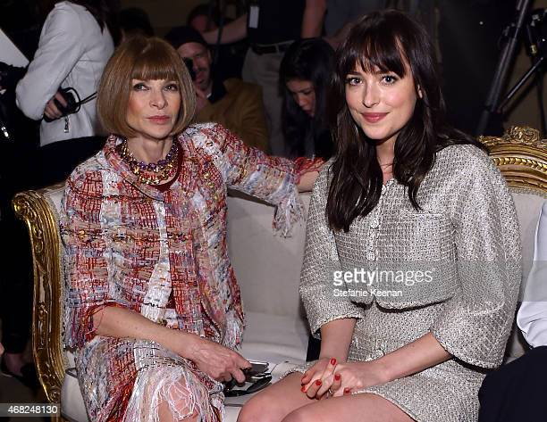 English editorinchief of American Vogue Anna Wintour and Dakota Johnson attend the CHANEL ParisSalzburg 2014/15 Metiers d'Art Collection in New York...