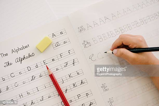 English education concept, alphabet writing practice on notebook
