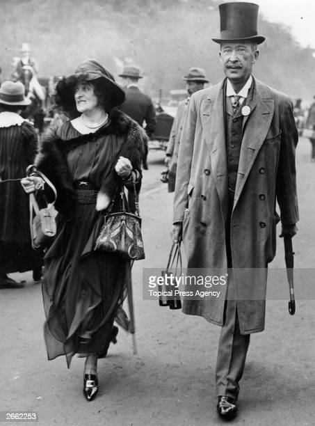 English Egyptologist and 5th Earl of Carnarvon George Edward Stanhope Molyneux with his wife at Ascot