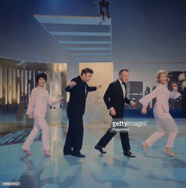 English entertainer and presenter Bruce Forsyth performs on stage with the comedian Frankie Howerd singer Julie Rogers and the dancer Aleta Morrison...