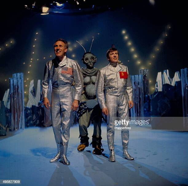 English entertainer and presenter Bruce Forsyth performs on stage with the singer and presenter Roy Castle both dressed as space men on his...