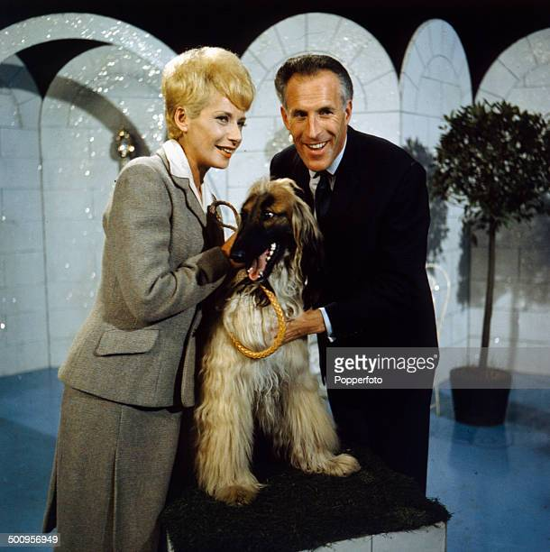 English entertainer and presenter Bruce Forsyth pictured with actress Miriam Karlin and a dog on the television series 'The Bruce Forsyth Show' in...
