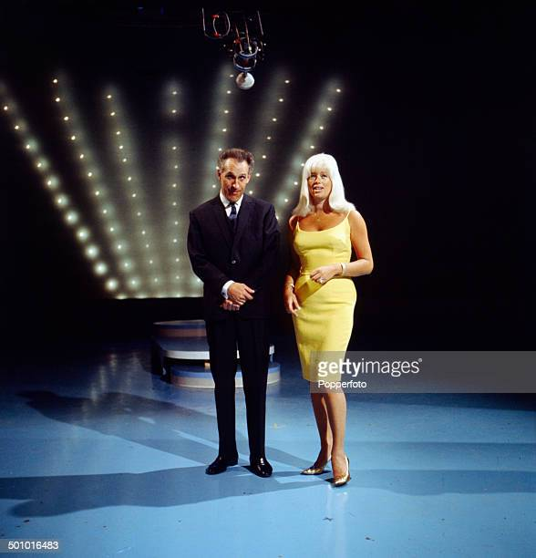 English entertainer and presenter Bruce Forsyth posed with the actress Diana Dors on the set of 'The Bruce Forsyth Show' in 1966