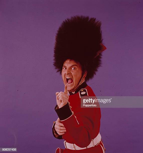 English entertainer Bob Monkhouse pictured wearing a British Guards uniform and bearskin cap in 1965