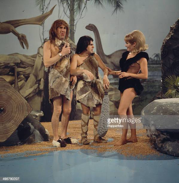English entertainer Bruce Forsyth pictured with English actor comedian and musician Dudley Moore in a prehistoric cave man scene on the television...