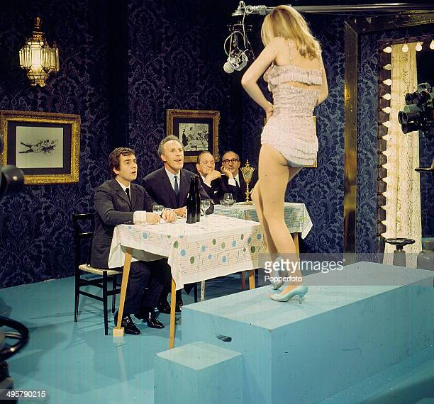 English entertainer Bruce Forsyth pictured with English actor comedian and musician Dudley Moore in a scene with an exotic dancer on the television...