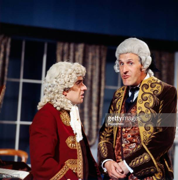 English entertainer Bruce Forsyth pictured with the actor musician and comedian Dudley Moore in a period costume sketch from the television series...