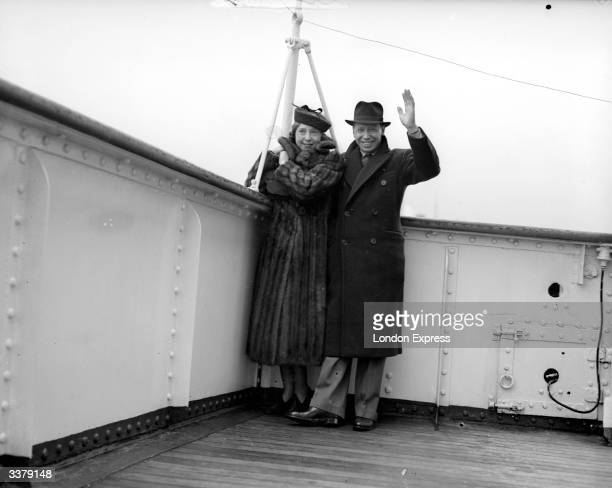 English entertainer George Formby and his wife Beryl on board a ship