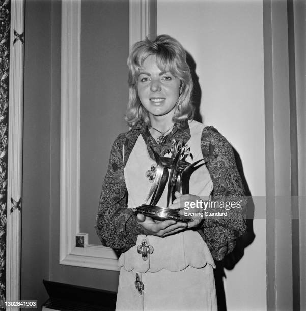 English equestrian Ann Moore with the Andrew and Booth Olympics Award for the Most Courageous British Performance, after she won a silver medal in...